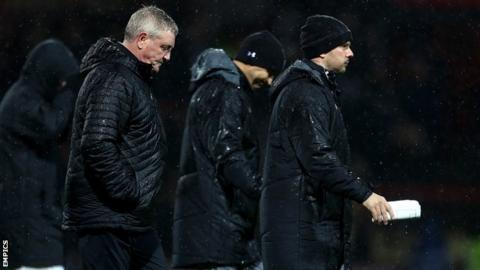 A wet night at Griffin Park turned into a miserable one for Steve Bruce and his backroom team Colin Calderwood and Stephen Clemence (right)