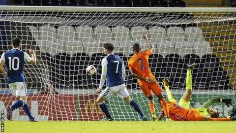 Oliver Burke slams in the opening goal for Scotland in Paisley