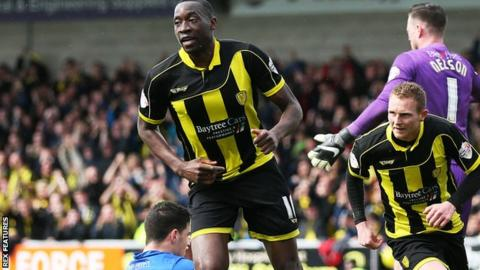 Burton's Lucas Akins celebrates scoring the opening goal against Gillingham