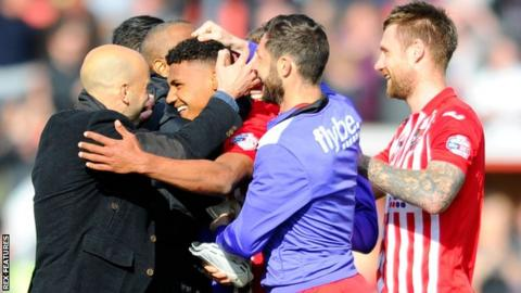 Paul Tisdale (left) led the congratulations for Watkins after his late goal secured victory over Plymouth Argyle