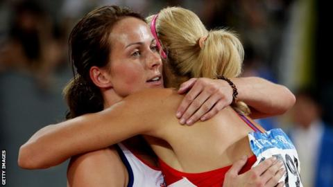 Tatyana Chernova hugs Kelly Sotherton after the women's heptathlon 800m final at Beijing 2008