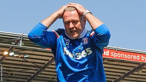 Paul Lambert with head in hands on the touchline with Stoke