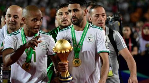Yacine Brahimi (left) celebrates with Riyad Mahrez after winning the Africa Cup of Nations
