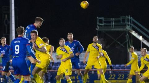 Chris McCart heads in Inverness' second goal