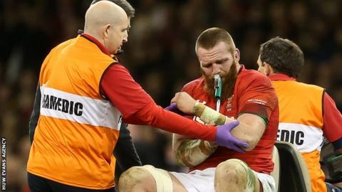 Jake Ball leaves the field after dislocating his shoulder playing for Wales against New Zealand