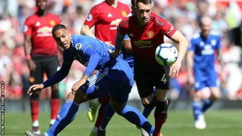 Kenneth Zohore challenges Manchester United's Phil Jones