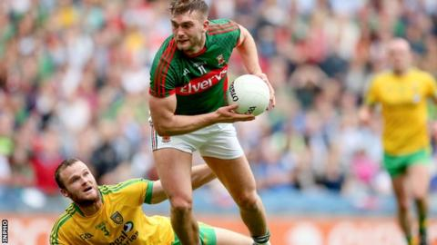 Aidan O'Shea overpowers Neil McGee to score Mayo's opening goal in their All-Ireland quarter-final win over Donegal