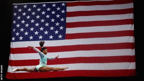 Simone Biles with the American flag