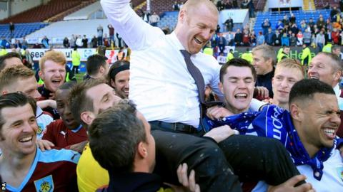 Sean Dyche and Burnley players celebrate promotion