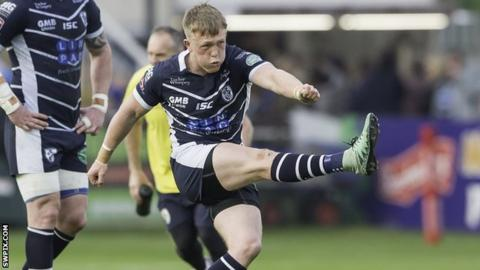 Cory Aston kicks a penalty for Featherstone against Halifax