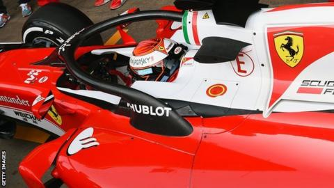 Ferrari's Kimi Raikkonen tests the new halo head protection system