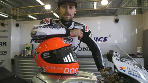 Eugene Laverty with the special helmet in tribute to Dr John Hinds