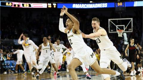 Jordan Poole #2 and Moritz Wagner #13 of the Michigan Wolverines celebrate Poole's 3-point buzzer beater for a 64-63 win over the Houston Cougars during the second round of the 2018 NCAA Men's Basketball Tournament at INTRUST Bank Arena on March 17, 2018