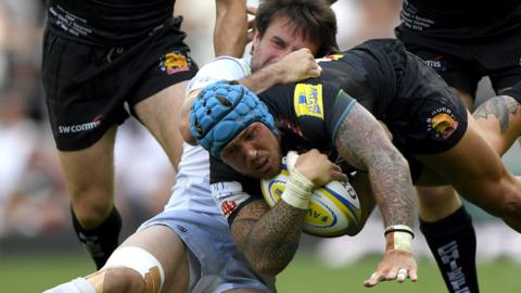 Marcelo Bosch of Saracens tackles Jack Nowell of Exeter Chiefs