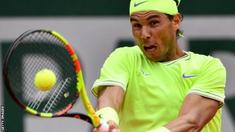 Nadal hits a backhand