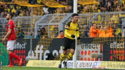Sancho sends Dortmund back on top