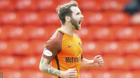 Dundee United's James Keatings celebrates