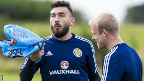 Scotland's Robert Snodgrass shares a joke with Steven Naismith