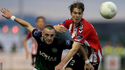 Dylan Connolly battles with Derry's Niclas Vemmelund at the Carlisle Grounds