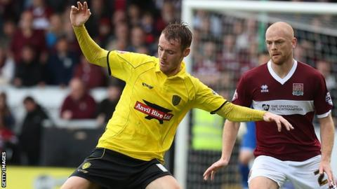 Tom Naylor (left) in action for Burton Albion against Northampton Town last season