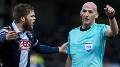 Ross County's Martin Woods remonstrates with referee Bobby Madden