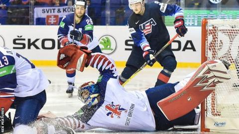 GB netminder Ben Bowns goes full length to make one of his 59 saves against USA