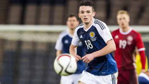 John McGinn in action for Scotland against Denmark in March