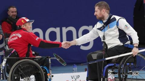 Scotland's Hugh Nibloe (right) shakes hands with a member of the Russian team