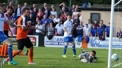 Ross Gaynor's cross sneaks inside the post to put the Blues ahead at Carrick