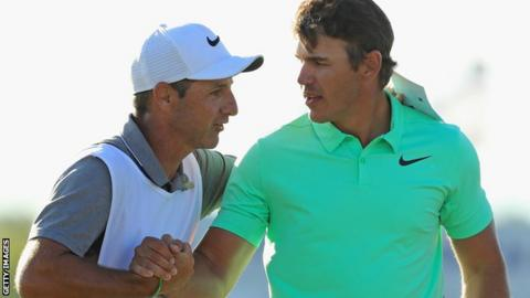 Caddie Ricky Elliott and Brooks Koepka embrace celebrate the US Open victory