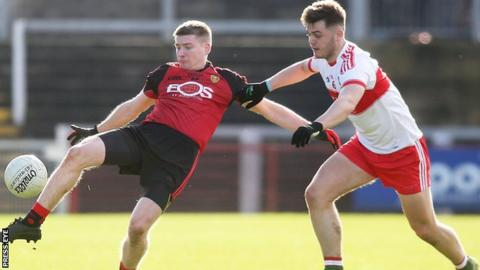 Down's Conor Maginn in action against Conor Nevin of Derry at Celtic Park