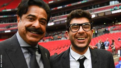 Tony Khan (right) with his father, Fulham owner Shahid Khan