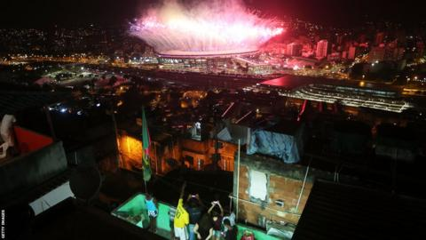 Fireworks explode over Maracana stadium with the Mangueira 'favela' community in the foreground during opening ceremonies for the Rio 2016 Olympic