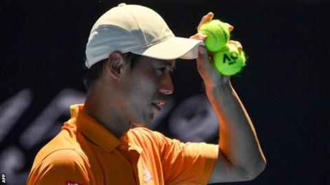 Australian Open: Kei Nishikori survives Karlovic test