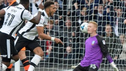 Derby's Cyrus Christie celebrates goals against Sheffield Wednesday