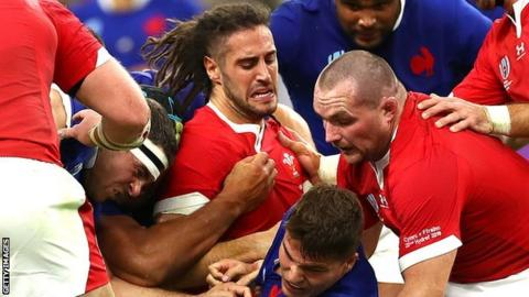 Josh Navidi in the thick of the action against France