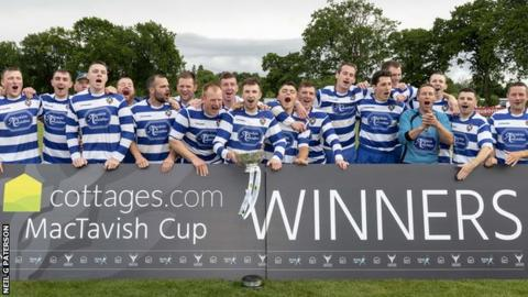 Newtonmore celebrate lifting the trophy once more at Bught Park