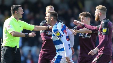 Angel Rangel clashes with Swansea City players during QPR's 4-0 Championship win