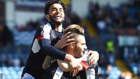 Dundee players celebrate with goal hero Marcus Haber