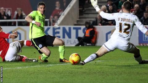 Tomer Hemed scores Brighton's third goal against Bristol City