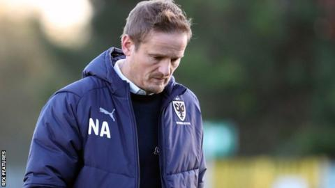 AFC Wimbledon boss Neal Ardley on the sidelines