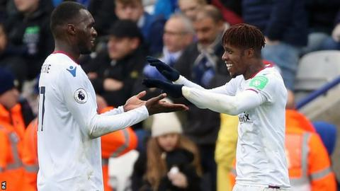Christian Benteke and Wilfried Zaha celebrate