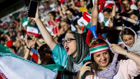 Iranian football supporters during screening of football match between Iran and Spain in Azadi stadium in the capital Tehran on June 20, 2018