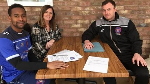 Louis Pedro signing terms with club secretary Sarah McKnight and head of recruitment Lee Dykes