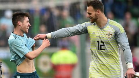 Northern Ireland goalkeeper Trevor Carson shares a joke with team-mate Paul Smyth