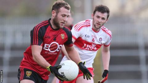 Down's Darren O'Hagan in action against Derry's Patrick Kearney at Pairc Esler