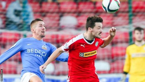 Glenavon's Daniel Kearns puts pressure on Tomas Cosgrove at Solitude