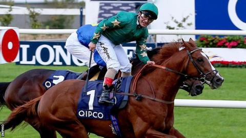 Andrea Atzeni shows his delight after guiding Decorated Knight to victory in the Irish Champion Stakes
