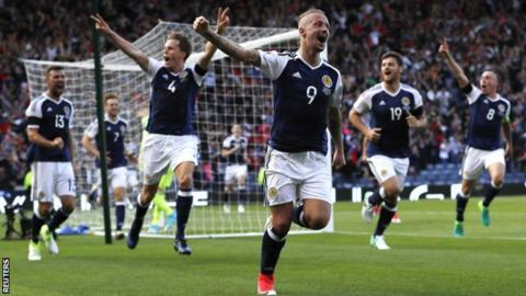 Leigh Griffiths celebrates one of his two strikes against England in the World Cup qualifier at Hampden