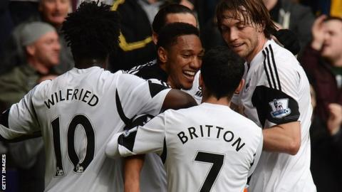 Jonathan de Guzman (centre) celebrates a goal with Wilfried Bony, Leon Britton and Michu